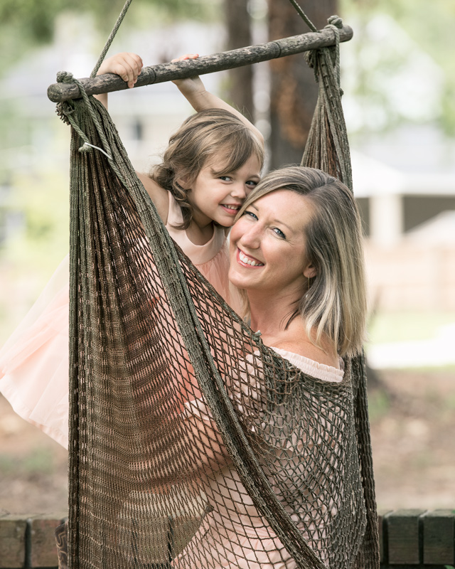 mother and daughter in swing