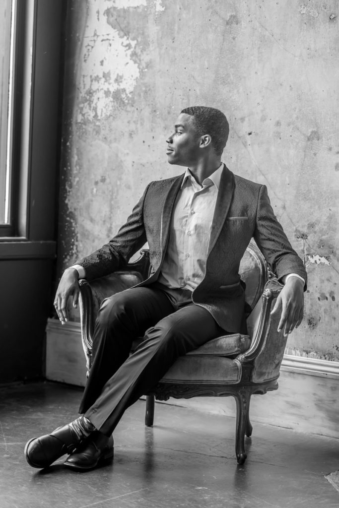 black and white creative portrait of man in chair