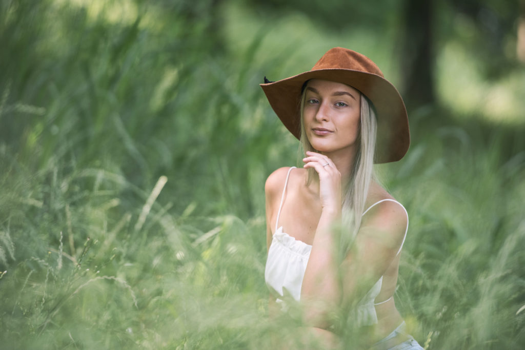 young woman posing in high grass