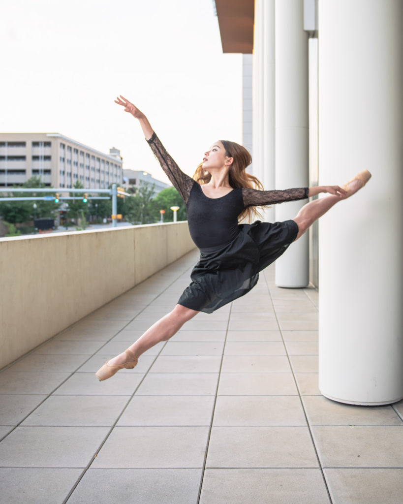 dance photography of ballerina leaping in city
